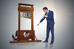The businessman in deadline concept with guillotine stock photo
