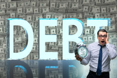 The businessman in debt business concept. Businessman in debt business concept stock images