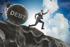 The businessman in debt loan business concept stock photo
