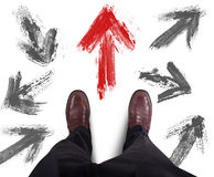 Businessman decided right direction. Businessman decided direction and follows the red arrow Stock Photography
