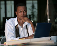 Businessman Deep In Thought Stock Photo