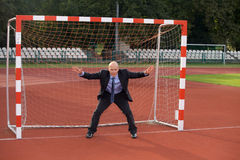 Businessman defending goal Stock Photos