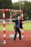 Businessman defending goal Stock Photography