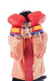 Businessman with boxing gloves - isolated. Businessman defense move with boxing gloves on white background Stock Image