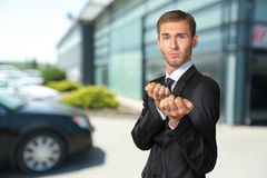 Businessman in a defensive position Stock Photos