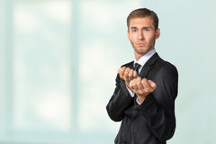 Businessman in a defensive position Royalty Free Stock Photo