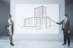 Businessman delivering architectural presentation Royalty Free Stock Image
