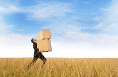 Businessman delivering boxes Royalty Free Stock Images