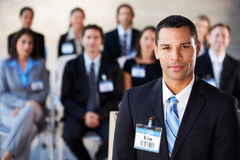 Businessman Delivering Presentation At Conference Royalty Free Stock Photography