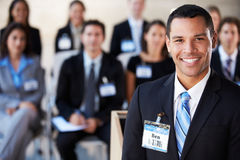 Businessman Delivering Presentation At Conference. Smiling Royalty Free Stock Photos