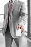 Businessman that delivers a business card Stock Photography