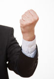 Businessman demonstrating his strong fist. White background Stock Photo