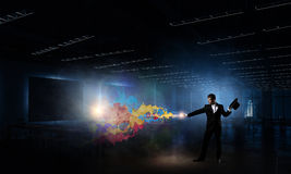 Businessman demonstrating magic . Mixed media Royalty Free Stock Photo