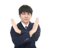 Businessman demonstrating prohibiting gesture. Asian businessman demonstrating prohibiting gesture Royalty Free Stock Photography