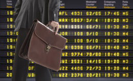 Businessman of departure board airport Royalty Free Stock Image