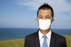 Businessman in depression with mask Stock Photo
