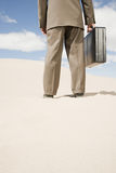 Businessman in the desert Stock Photo