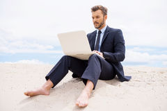 Businessman in desert. Royalty Free Stock Images
