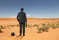 Businessman in desert Stock Photos