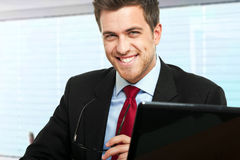 Businessman at desk Royalty Free Stock Images