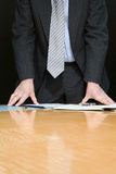 Businessman by desk Royalty Free Stock Photo