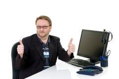 Businessman on desk. Middle aged businessman self assured, formal dressed, studio shot Royalty Free Stock Photos