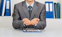 Businessman at the desk at office Stock Images