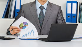 Businessman at the desk at office stock image