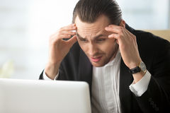 Businessman in despair because of bad news royalty free stock photos