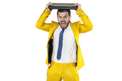 Businessman destroying a computer on his head Stock Photography