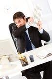 Businessman destroying computer using keyboard Stock Photo