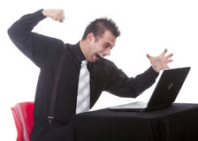 Businessman destroying his PC. Frustrated businessman destroying his PC with fist Stock Photo