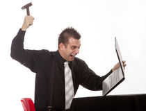 Businessman destroying his PC. With a hammer Stock Images