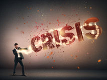 Businessman destroying word crisis Stock Images