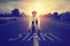 A businessman is determined to start on the road. Royalty Free Stock Image