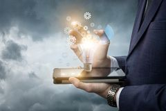 Businessman develops the idea of a tablet. In the sky Royalty Free Stock Image