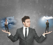 Businessman with devil or angel Stock Photography