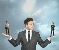 Businessman with devil and angel. Businessman must choose between the devil or angel Stock Photography