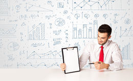 Businessman with diagram background Royalty Free Stock Photo