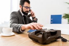 businessman dialing number with stationary telephone royalty free stock photo