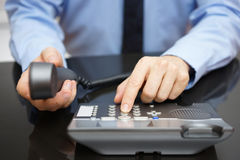Businessman is dialing on telephone keypad Stock Images