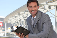 Businessman with diary Royalty Free Stock Image