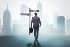 The businessman in difficult choice concept Stock Photos