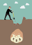 Businessman digging a ground to find a treasure Royalty Free Stock Image
