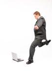 Businessman digging laptop Royalty Free Stock Images