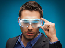 Businessman with digital glasses Stock Images