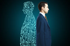Businessman with digital partner. Standing back-to-back on dark background stock photography