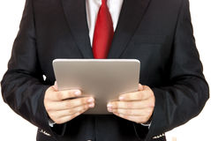 Businessman and digital tablet Stock Photography