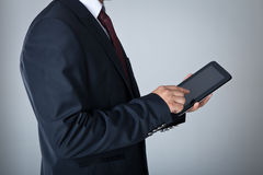 Businessman with digital tablet Stock Images