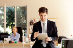 Businessman with digital tablet Royalty Free Stock Photos